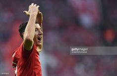Bayern Munich's Polish striker Robert Lewandowski celebrates scoring the 2-0 goal during the German first division Bundesliga football match FC Bayern Munich vs Schalke 04 in Munich, southern Germany, on April 16, 2016. / AFP / CHRISTOF