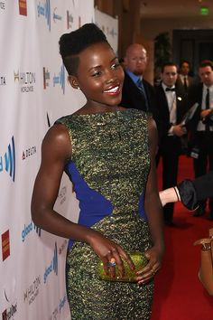 Antonio Berardi Dress, Judith Leiber Clutch, Leroy's Place Grace Jones Ring, Joan Hornig Ring & EF Collection Earrings