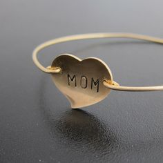 Love for Mom, Personalized Hand Stamped Heart Bangle Bracelet, Mothers Day Gift, Birthday Gift for Mom, Jewelry, Custom, Mothers Bracelet. $27.95, via Etsy.