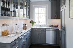 small u shape kitchen with grey cabinets and white granite countertop                                                                                                                                                                                 More
