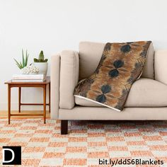 This intricately detailed throw blanket features an abstract symmetrical pattern of brown and navy blue exotic chicken feathers creating what looks like a tribal design. https://society6.com/product/brown-chicken-feathers-abstract-pattern_throw-blanket?curator=debidalio #homedecor #bedding #home #decor #abstractart #pattern #StudioDalio