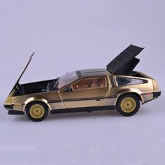 86.29$  Buy now - http://alitk9.worldwells.pw/go.php?t=32781056914 - Diecast Alloy Car Model Toys 1/18 Scale Back to the Future Gold Color Stainless Steel Model For   Children Gifts Collections Fre