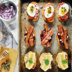 This trio features bruschetta with peanut butter mousse and banana, bacon with goat cheese and jam, and smoked salmon with egg and capers.