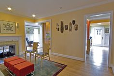 Light borrowed from the nearby kitchen and dining room enhance this living room.