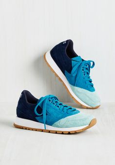 Bustling days are all the more reason to look your fiercest, and these suede sneakers by Brooks Heritage are ready to rock and 'stroll'! Lace into their aqua, lagoon, and navy uppers and cushioned insoles, put their treaded soles to the pavement, and see how far these sporty kicks take ya. Hint - it'll be far!