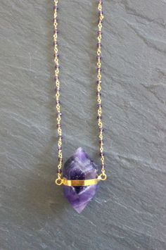 Amethyst Crystal plated in gold, on a custom length hand made Purple Crystal chain.  Your necklace will arrive with a descriptive hang tag, wrapped in tissue paper and in a Goddess gift box.