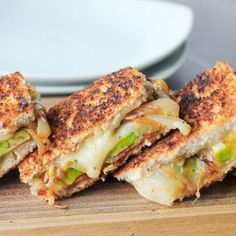 The Ultimate Mini Grilled Cheese. Mini grilled cheese loaded with cheddar bacon avocado and caramelized onions. #sandwiches #wraps #recipes A buttery and toasty grilled cheese sandwich stuffed with cool and creamy guacamole, crispy bacon and melted jack and cheddar cheese. The crunchy crumbled tortilla chips in this grilled cheese pay tribute to the classic combination of tortilla chips and guacamole dip. #Bacon #GuacamoleGrilled #Cheese #Sandwich