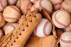 Glove on Pile of Old Baseballs. Sports Photos