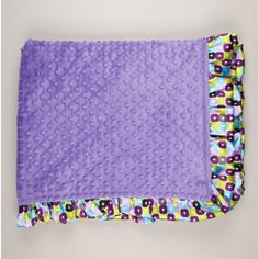 Satin ruffle toddler blanket.