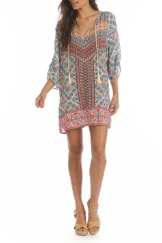 Gorgeous silk tunic / mini dress can be dressed up with heels or worn as a beach cover up! Sleeves are just past the elbow and are slightly rouched. V neck with off white long tassels add a fabulous BoHo vibe. Primary colors are off white, pink, coral and orange.   Silk Print Dress by Tolani. Clothing - Dresses - Printed Clothing - Dresses - Casual Boston, Massachusetts