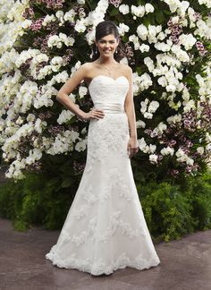 Sincerity brautkleid style 3722 A slim mermaid gown with a sweetheart neckline in beaded lace and tulle  accented with a regal satin cummerbund. Buttons cover the the back  zipper and this style has a sweep length train.
