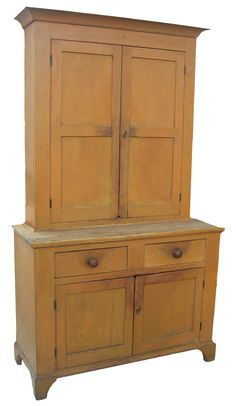 Early 19th century, pine, Stepback Cupboard, Two piece, the upper section with two paneled doors and old red paint on the interior; the lower section with two drawers over two doors, all resting on bracket feet. Retains, persimmon paint. circa 1820 - 1830 ...~♥~