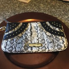 Nine West wristlet Black and white wristlet with gold medal accent, brand new Nine West Bags Clutches & Wristlets