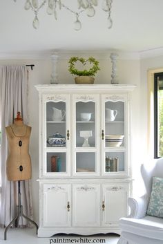 beautiful large ornate cabinet painted a crisp white with grey inside