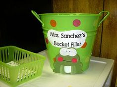 This was used in a classroom that I worked in just outside of Milwaukee. It worked GREAT! The goal is to fill the bucket by the end of the week. When children are spotted doing something good they can write their name on a piece of paper and fill the bucket. At the end of the week a name is picked to win a prize. -Kayla Gavigan