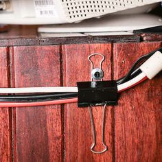 organize cords: attach a binder clip with a washer and screw and run cords through