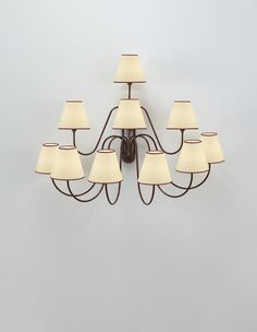 """JEAN ROYÈRE Ten-armed """"Bouquet"""" wall light, circa 1950  Painted metal, paper shades. 33 1/4 x 42 1/2 x 22 in. (84.5 x 108 x 55.9 cm)"""