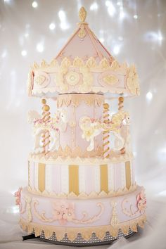 Watch and learn along with Paul as he creates this stunning, show stopping, competition style Carousel Cake. The Carousel even rotates! Note that the central pillar is 4″ round by 6″ high