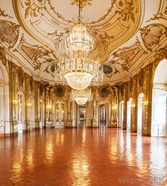 Baroque/Rococo architecture and interiors are beautifully constructed to add detail to the room. The chandeliers are also classic and extravagant.