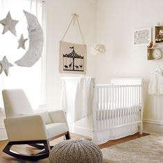 paper moon and stars are perfect for this sophisticated white nursery