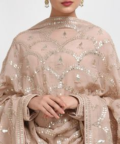 <p>From our Wedding and Bridal Collection, this is an oyster pink pure crepe suit with intricate exquisite silvery gold gota patti and gold dabka work hand embroidery. The gota patti embroidered on the shirt at front-back neckline and sleeve ends. T