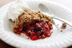 Triple Berry Crisp  Gina's Weight Watcher Recipes  Servings: 8 • Serving Size: 1/8th • Old Points: 4 pts • Points+: 6  Calories: 210.5 • Fat: 6.9 g • Protein: 2.9 g • Carb: 40 g • Fiber: 5.1 g • Sugar: 23.3 g  Sodium: 11.5 mg     Ingredients:    For the filling:  1 1/2 cups sliced strawberries  1 1/2 cups blueberries  1 1/2 cups raspberries  1/4 tsp cinnamon  1 tsp lemon zest  2 tsp cornstarch  1/4 cup sugar or agave nectar  For the topping:  1 cup Quaker quick oats  1/2 cup whole wheat…
