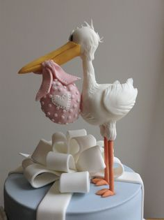 Close up of stork. Hand modelled in sugar paste to match baby shower invitations