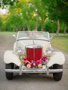 Cruise away in a classic MG TD convertible. Florals by Birdie Blooms. Photo by Candi Coffman Photography. #wedding #classiccar #weddingstyle #flowers #Americana