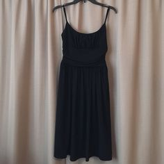 """WHBM Little Black Dress - Sz 2 Classic little black dress from White House Black Market. Dress has elegant A-Line styling with forgiving rouching around the waist. Adjustable spaghetti straps and flowy skirt. Dress has a bit of stretch to it and is fully lined. Hits just at the knee (I'm 5'7""""). Worn once and in like new condition. Size 2. White House Black Market Dresses"""