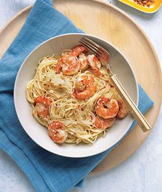 Angel Hair with Spicy Shrimp.  My husband and I enjoyed this with some homemade pita chips for our Easter lunch!  We would recommend letting the garlic brown, despite the recipe's directions not to, and letting the shrimp get nice and grilled with it.  Then add the white wine, etc..  We also used whole wheat pasta.  Very good!  We'll make it again!
