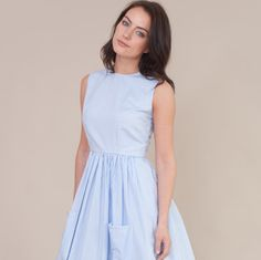 Vintage inspired dress with sleeveless fitted bodice and round neckline. The skirt is gathered at the waist with 2 large pockets at the front.