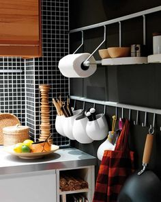 Practical kitchen rail storage ideas.