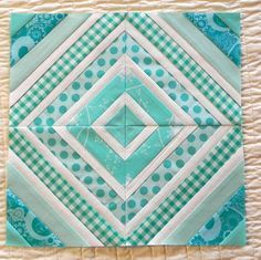 I like that every other strip is white on this string quilt block - powerful at integrating and smoothing the overall look, despite the variability in the scraps. You could increase the range of values of the blue-greens across the quilt surface - or do the whole top in the same tight range of hue and value - or alternate blues and corals -- or do a ROYGBIV across the surface. What fun! This is why you need a design wall.