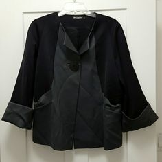 Marimekko Ritva Falla Jacket Marimekko Ritva Falla Jacket.  Black and gray.  63% wool,  37% polyester.  Fully lined in acetate viscose blend. Wrinkled, but no flaws.  European size 40, which is about a US 10. This is a thin jacket, not a thick warm jacket. Marimekko  Jackets & Coats