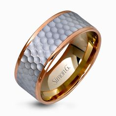 This distinctive men's wedding band features a contemporary hammered design in white gold encircled white two dazzling rose gold silhouettes. Print Page
