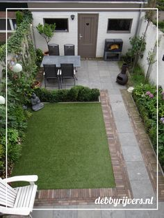 Amazing Small Backyard Garden With Bluestone Tiles, Artificial Grass And Lots Of  Evergreens