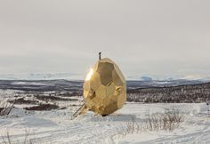 Solar Egg is a golden sauna in Kiruna, Sweden