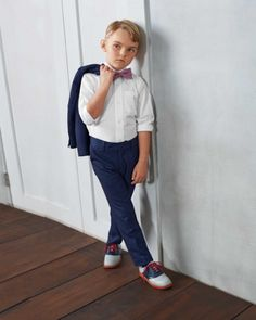 boys white dress shirt - The finely textured white dress shirt has a straight collar, adjustable cuffs and a chest pocket. It's extremely versatile -- he can wear it with trousers, jeans, khakis, over a tee . . . the possibilities are endless.