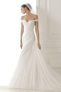 Would you wear this Pronovias draped wedding dress with off-the-shoulder sweetheart neckline?