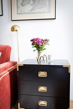 Love the idea of a furniture with a bold, deep color accented by brass details.