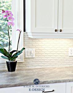 Cloud White cabinets, hexagon subway tile backsplash, formica soapstone countertops. Kylie M E-design