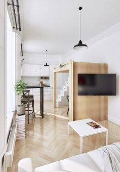 Small Apartment Showcase The Flexibility Of Compact Design. The slatted wall also doubles as a place to hang the television, allowing the sofa to face outward toward the room rather than toward one of the permanent walls. 30 square meters.