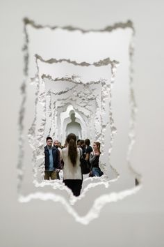 The Future Was Then exhibition by Daniel Arsham features eroded, rippled and cloth-like wall installations