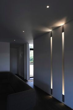 White interior with integrated lighting design by Kreon _