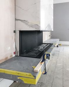 Work in progress: Vero Design Gala three-sided fire clad in polished statuario and grey large format porcelain. Large Format, Luxury Homes, Beautiful Homes, Tiles, Porcelain, Desk, Fireplace Ideas, Furniture, Grey