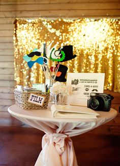 Photo booths are such a fun way to give your guests an extra special treat during an event. Whether you're planning a wedding, birthday, or just entertaining at home, you can set up a DIY photo booth in very little time with things you already own! Supplies Needed: A camera A backdrop Good lighting