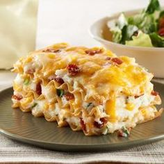 Easy Pierogi Casserole 9 lasagna noodles, uncooked 4 cups hot mashed potatoes 1/2 cup PHILADELPHIA Herb & Garlic Cream Cheese Spread 6 green onions, thinly sliced 1 (80 gram) package Oscar Mayer Real Bacon Recipe Pieces, divided 2 cups KRAFT Double Cheddar Shredded Cheese, divided