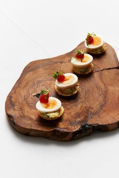 Cotswold quails egg with dill mayonnaise and tomato pickle served in a crispy Berkswell cheese cup