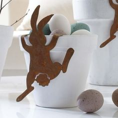 Cute Bunny alongside a pot filled with eggs! I could make these out of felt and superglue on pot