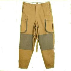 U.S. World War II Reproduction Paratroopers Pants, Khaki with OD (S-M) Style was used 1942-1944. Sizes S/M OR L/XL. Cotton Twill with Leather Bill, Sweatband, and Chin Strap. Made from a tough cotton blend material. Machine wash/dry. Features slash front pockets, 2 rear pockets with single button closure, double button-close cargo pockets, small pocket above right slash for a lighter or compass, c... #CUSTOM #Apparel